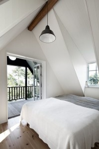 This room works because an all-white scheme allows the windows and rooflines become the main feature.