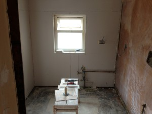 Plasterboard added on bare walls, bonding coat plaster added to repair the others
