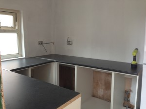 Worktops cut down to size and laid in place