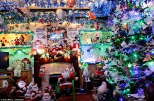 Christmas heaven! Source: http://www.dailymail.co.uk/news/article-2251534/Christmas-mad-pensioners-spend-10-000-transforming-home-sparkling-winter-wonderland-2-500-lights-300-Santas.html