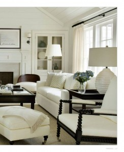 This white scheme is grounded with the dark wood of the furniture. It's easier to photograph than the middle picture, because the dark wood provides balance and contrast.
