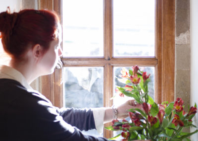 Anna arranging flowers